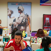 JUNE 28, 2016 --- COROZAL, PUERTO RICO<br /> Break room decorated with flags for the different branches of the military and action photographs of US Army soldiers wearing the product the company makes at Bluewater Defense in Corozal. The company makes pants for the US Army.<br /> (Photo by Angel Valentin/Freelance)