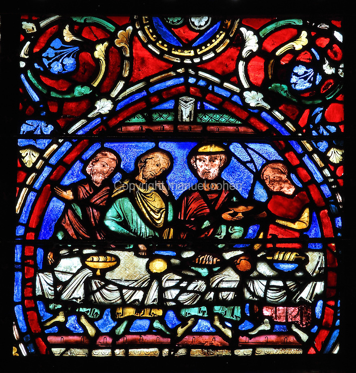 The father shares his celebratory meal with his 2 sons, while a servant brings more dishes. The Reunion Feast, from the Parable of the Prodigal Son stained glass window, in the north transept of Chartres Cathedral, Eure-et-Loir, France. This window follows the parable as told by St Luke in his gospel. It is thought to have been donated by courtesans, who feature in 11 of the 30 sections. Chartres cathedral was built 1194-1250 and is a fine example of Gothic architecture. Most of its windows date from 1205-40 although a few earlier 12th century examples are also intact. It was declared a UNESCO World Heritage Site in 1979. Picture by Manuel Cohen