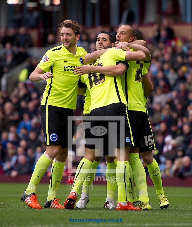 Bobby Zamora of Brighton and Hove Albion (right) celebrates after scoring his team's 1st goal to make it 1-0 during the Sky Bet Championship match at Turf Moor, Burnley<br /> Picture by Russell Hart/Focus Images Ltd 07791 688 420<br /> 22/11/2015