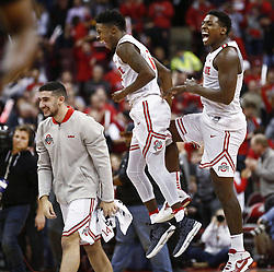 December 4, 2017 - Columbus, OH, USA - Ohio State Buckeyes guard Joey Lane (14), left, Ohio State Buckeyes guard Kam Williams (15), center, and Ohio State Buckeyes forward Jae'Sean Tate (1), right, celebrate defeating the Michigan Wolverines on Monday, Dec. 4, 2017, at Value Center Arena in Columbus, Ohio. (Credit Image: © Fred Squillante/TNS via ZUMA Wire)