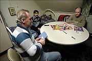 Nederland, Nijmegen, 16-2-2004..In een voormaligklooster in Nijmegen hebben 150-200 arbeidskrachhten uit Polen tijdelijke huisvesting. Via een uitzendbureau, SBA-Euro werken zij in o.a de vleesverwerkende industrie, kastuinbouw en fabrieken...Afkomstig uit Silezie hebben zij een Duits paspoort en zijn legaal hier. Alle voorzieningen zijn in het gebouw aanwezig. Sommigen werken al 3 tot 6 jaar hier. ..Economie, werkloosheid, arbeidsmigratie, EU, europese unie. Arbeidsmarkt. Werkvergunning...Foto: Flip Franssen/Hollandse Hoogte