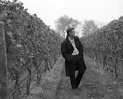 man standing in a vineyard in East Hampton, NY