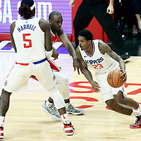 28 February 2018: LA Clippers guard Lou Williams (23) drives past Houston Rockets forward Luc Mbah a Moute (12) on a screen set by LA Clippers forward Montrezl Harrell (5) during the Houston Rockets 105-92 victory over the LA Clippers, at the Staples Center, Los Angeles, California, USA.