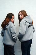 Two girls wearing Schott hoodies
