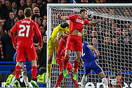 Rickie Lambert of Liverpool beats Thibaut Courtois of Chelsea to the ball but the referee blows for a foul during the Capital One Cup Semi Final 2nd Leg match between Chelsea and Liverpool at Stamford Bridge, London, England on 27 January 2015. Photo by David Horn.