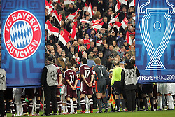Munich, Germany - Wednesday, March 7, 2007:  Bayern Munich and Real Madrid banners are carried before the UEFA Champions League First Knock-out Round 2nd Leg at the Allianz Arena. (Pic by Christian Kolb/Propaganda/Hochzwei) +++UK SALES ONLY+++
