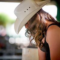 Michaela Webb of High Desert Grange takes a moment on her phone on the opening day of the San Bernardino County Fair in Victorville, Saturday, May 24, 2014.  (Eric Reed/For The Sun)