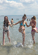 01/07/2014 Salthill Girls Laoise Smyth , Caoirse Mulligan and  Jenny Flaherty enjoying the sunshine in Salthill Galway. Photo:Andrew Downes