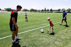 Callum O'Dowda plays with a young supporter after the Open training session on Day 5 - Rogan/JMP - 15/07/2019 - IMG Academy, Bradenton - Florida, USA - Bristol City Pre-Season Tour Day 5.