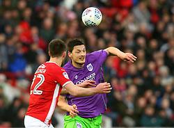 Milan Djuric of Bristol City takes on Gary Gardner of Barnsley - Mandatory by-line: Robbie Stephenson/JMP - 30/03/2018 - FOOTBALL - Oakwell Stadium - Barnsley, England - Barnsley v Bristol City - Sky Bet Championship