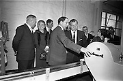 26/09/1962<br /> 09/26/1962<br /> 26 September 1962<br /> Opening of Earl Bottlers Ltd. at South Earl Street, Dublin. Minister for Justice Charles Haughey opened the new premises that produced Sandyman port. Picture shows Mr Haughey  being shown around the plant by Mr W. Campbell, Director of Earl Bottlers.