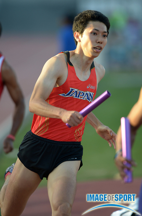 Apr 20, 2013; Walnut, CA, USA; Hideyuki Hirose runs the third leg on the Japan 4 x 400m relay that won the invitational race in 3:06.00 in the 55th Mt. San Antonio College Relays at Hilmer Lodge Stadium.