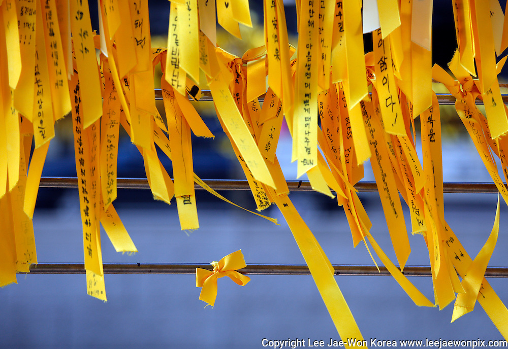 Yellow ribbons are hung at the Cheonggye plaza in Seoul May 3, 2014. People wrote their whishes for the return of missing people after the Sewol ferry was sunken in waters off the southwestern island of Jindo on April 16, 2014. Photo by Lee Jae-Won (SOUTH KOREA) www.leejaewonpix.com/