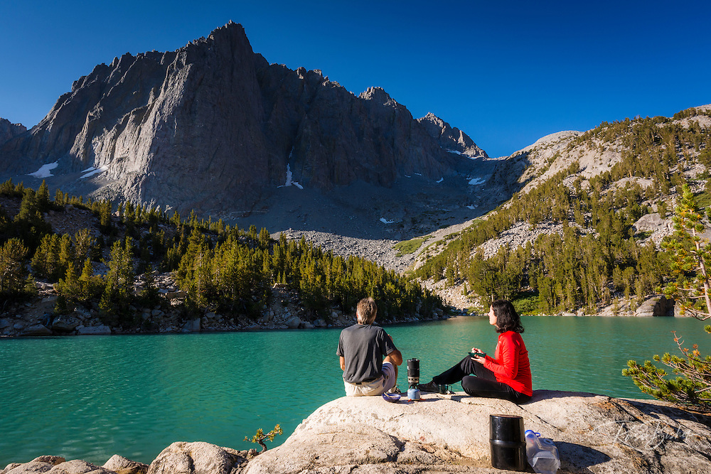 Hikers enjoying breakfast at Big Pine Lake #3, John Muir Wilderness, Sierra Nevada Mountains, California USA