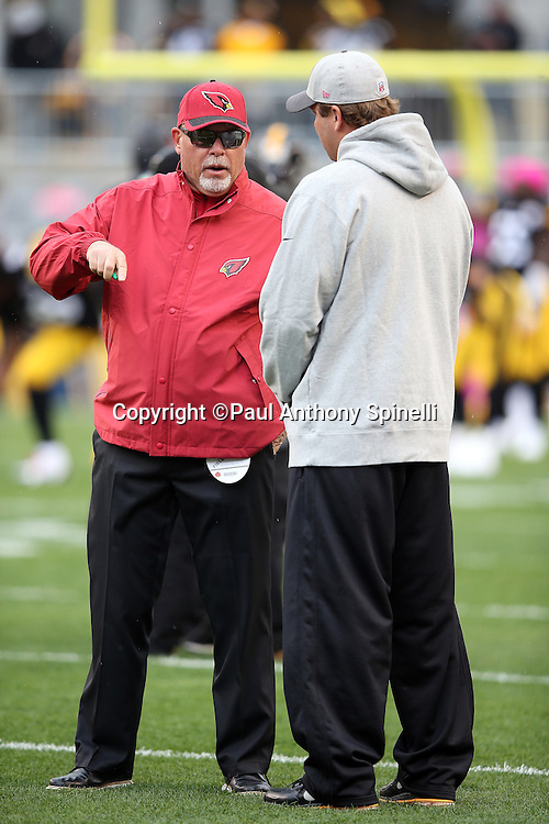 Arizona Cardinals head coach Bruce Arians talks to Pittsburgh Steelers quarterback Ben Roethlisberger (7) before the 2015 NFL week 6 regular season football game against the Pittsburgh Steelers on Sunday, Oct. 18, 2015 in Pittsburgh. The Steelers won the game 25-13. (©Paul Anthony Spinelli)