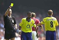 Photo: Richard Lane.<br />Arsenal v Manchester United. The FA Charity Shield 2003. 10/08/2003.<br />Ashley Cole is booked for a challenge on Nicky Butt by Steve Bennett.