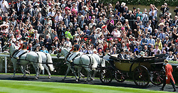 © licensed to London News Pictures. 14/06/2011. Ascot, UK.  HRH The Queen enters the winners circle on day one at Royal Ascot races today (14/03/2011). The 5 day showcase event,  one of the highlights of the racing calendar is in it's 300th year. Horse racing has been held at the famous Berkshire course since 1711 and tradition is a hallmark of the meeting. Top hats and tails remain compulsory in parts of the course. Photo credit should read: Ben Cawthra/LNP