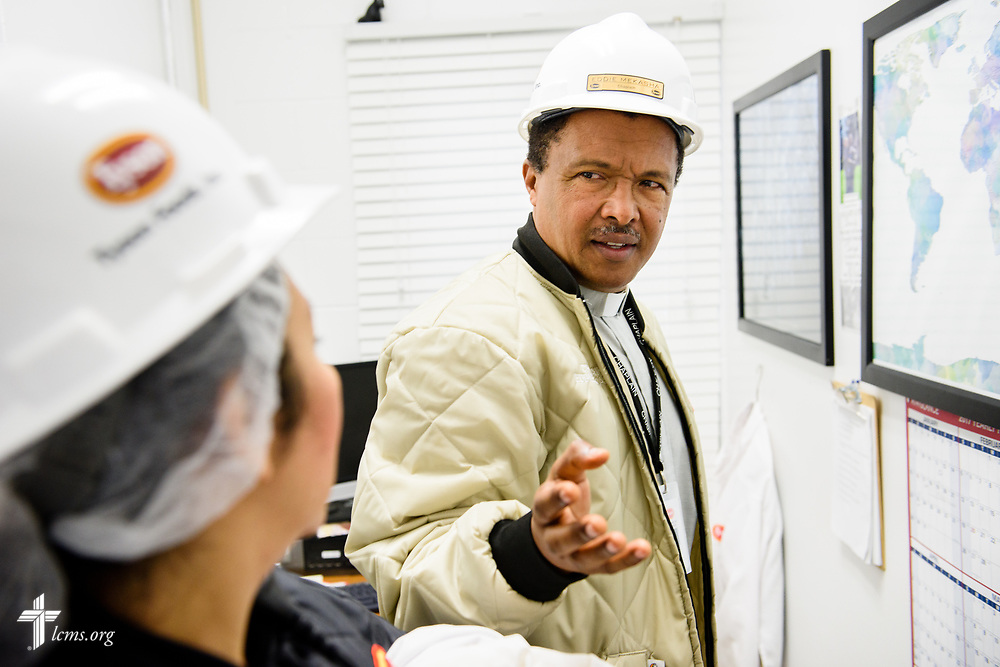The Rev. Eddie Mekasha, chaplain at Tyson Foods, talks with a coworker before touring the plant line on Wednesday, June 7, 2017, in Council Bluffs, Iowa. LCMS Communications/Erik M. Lunsford