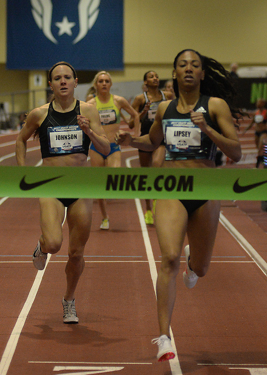 apl030517g/SPORTS/pierre-louis/030517/JOURNAL<br /> Charles Lipsey,, right , wins the Women 1000 Meter  Run during the USA Indoor Track and Field Championships held at the Albuquerque Convention Center ahead of Lauren Johnson,, .Photographed  on Sunday March 5, 2017. .Adolphe Pierre-Louis/JOURNAL