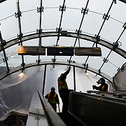 December 12, 2016 - New York, NY :  Work continues on the street-level escalator at the 96th Street Second Avenue subway station on Monday morning. After years of delays, the new subway line is preparing to welcome its first straphangers. CREDIT: Karsten Moran for The New York Times