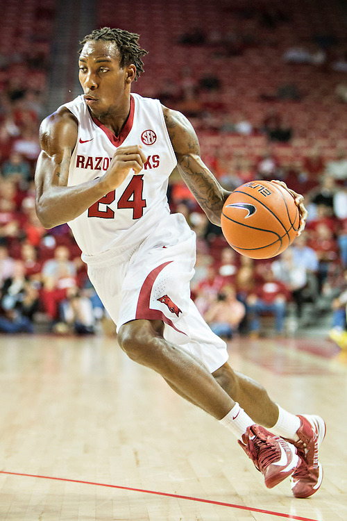 FAYETTEVILLE, AR - DECEMBER 3: Michael Qualls #24 of the Arkansas Razorbacks dribbles to the basket against the SE Louisiana Lions at Bud Walton Arena on December 3, 2013 in Fayetteville, Arkansas.  The Razorbacks defeated the Lions 111-65.  (Photo by Wesley Hitt/Getty Images) *** Local Caption *** Michael Qualls