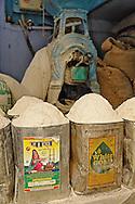 Tin cans of fresh ground flour, Delhi, India