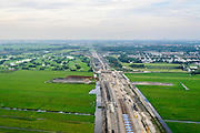 Nederland, Zuid-Holland, Midden-Delfland, 28-09-2014; aanleg A4 Midden-Delfland door Polder Vockestaert. Den Haag en Delft aan de horizon.<br /> Construction extension A4 motorway through the polder Vockestaert, between Delft and Rotterdam. <br /> luchtfoto (toeslag op standard tarieven);<br /> aerial photo (additional fee required);<br /> copyright foto/photo Siebe Swart