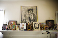 Family pictures on the mantle of the home of Robert Dixon, Sr., in Stockton, Ca., on Saturday, May 14, 2011. Robert Dixon, Sr., waits for his son, Robert Dixon, Jr., who was denied parole after a psychological evaluation deemed him a psychopath despite transforming his life through completing education courses and self-improvement seminars.
