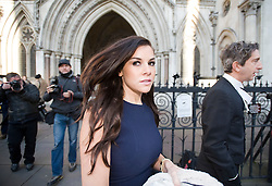 © Licensed to London News Pictures. 15/12/2011. London, UK.  Former Big Brother star Imogen Thomas leaving the High Court today (15/12/2011) after listening to a statement being read in relation to to an injunction granted earlier this year to a married footballer. Photo credit: Ben Cawthra/LNP