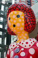 10 metre tall 'Yayoi-Chan' and 'Ring-Ring'' (2012) made by japanese artist Yayoi Kusama, in the Roppongi Hills arena, in Roppongi, Tokyo, Japan, on Sunday 25th March 2012. Exhibited as part of Roppongi Art Night 2012.