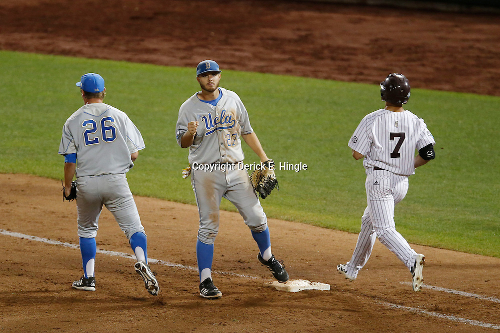 Jun 24, 2013; Omaha, NE, USA; UCLA Bruins pitcher David Berg (26) and first baseman Pat Gallagher (27) celebrate after game 1 of the College World Series finals against Mississippi State Bulldogs outfielder Jacob Robson (7) at TD Ameritrade Park. UCLA defeated Mississippi State 3-1. Mandatory Credit: Derick E. Hingle-USA TODAY Sports
