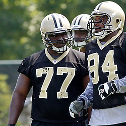 June 6, 2012; Metairie, LA, USA; New Orleans Saints defensive tackle Brodrick Bunkley (77) and defensive end Cameron Jordan (94) during a minicamp session at the team's practice facility. Mandatory Credit: Derick E. Hingle-US PRESSWIRE