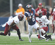 Mississippi running back Jaylen Walton (6) runs past Troy cornerback Femi Odaibo (6) and Troy linebacker Mark Wilson  (35) at Vaught-Hemingway Stadium in Oxford, Miss. on Saturday, November 16, 2013. (AP Photo/Oxford Eagle, Bruce Newman)