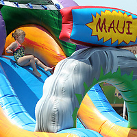 Gracie Edwards, 2, of Saltillo, slides down the inflatable waterslide as she enjoys the day out at the Dudie Burger Festival at the Oren Dunn City Museum in Tupelo.