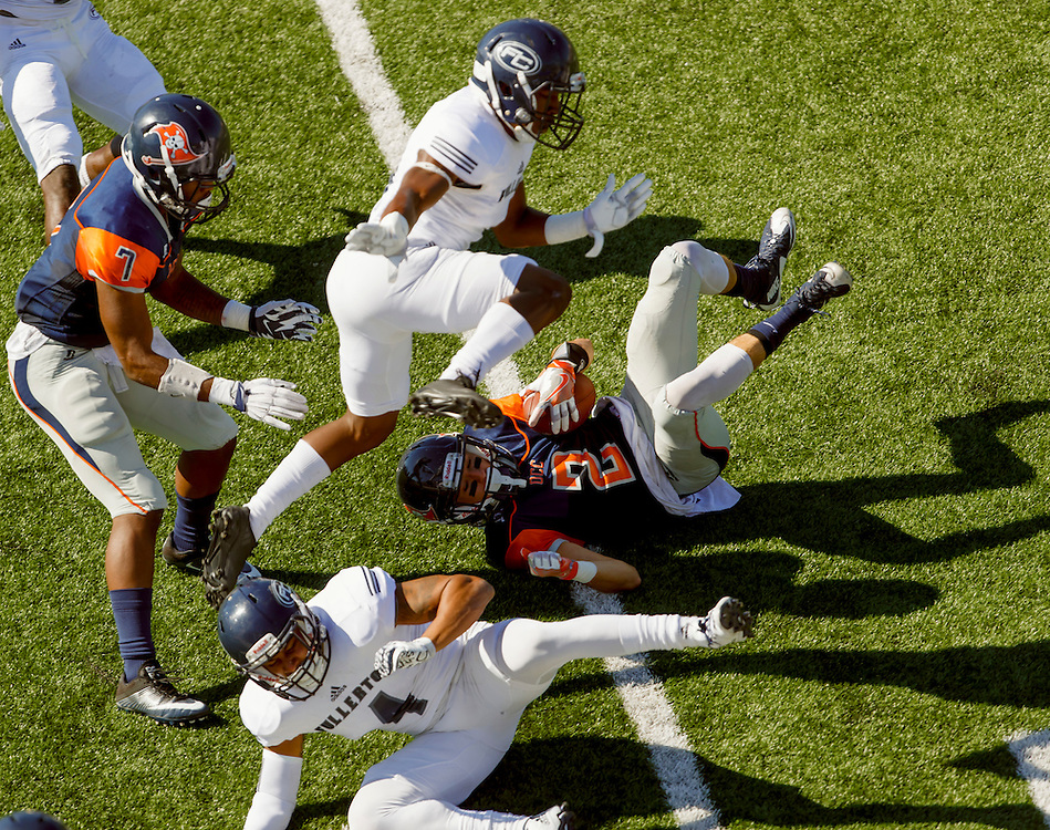 161105 Football, NCAA, OCC Pirates - Fullerton Titans<br /> Orange Coast Pirate wide receiver Robert Thomas (7) watches Orange Coast Pirate wide receiver Joey Cox (2) laying on the turf with the ball, and Fullerton Hornet defensive back Dwayne Wood (4) in front of him.<br /> © Daniel Malmberg/Sports Shooter Academy 13