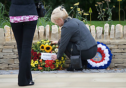 © licensed to London News Pictures. 08/09/2011. Brize Norton, UK..Flowers being laid at the memorial in Carterton before the body of Sergeant Barry Weston of 42 Commando Royal Marines is repatriated. Sgt Weston was killed on August 30 while leading a patrol near the village of Sukmanda in southern Nahr-e Saraj, Helmand province. Photo credit: Ben Cawthra/LNP