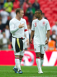 LONDON, ENGLAND - Saturday, June 2, 2012: England's Wayne Rooney and Ashley Cole after the 1-0 victory over Belgium during the International Friendly match at Wembley. (Pic by David Rawcliffe/Propaganda)