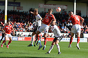 Walsall defender James O'Connor gets in a header during the Sky Bet League 1 match between Walsall and Crewe Alexandra at the Banks's Stadium, Walsall, England on 26 September 2015. Photo by Alan Franklin.