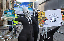 "St James, London, May 12th 2016. Protesters from transparency and accountability group One demonstrate demanding ""a new, global standard of transparency that could end the corruption that keeps people poor"". PICTURED: Protesters outside the conference security cordon."