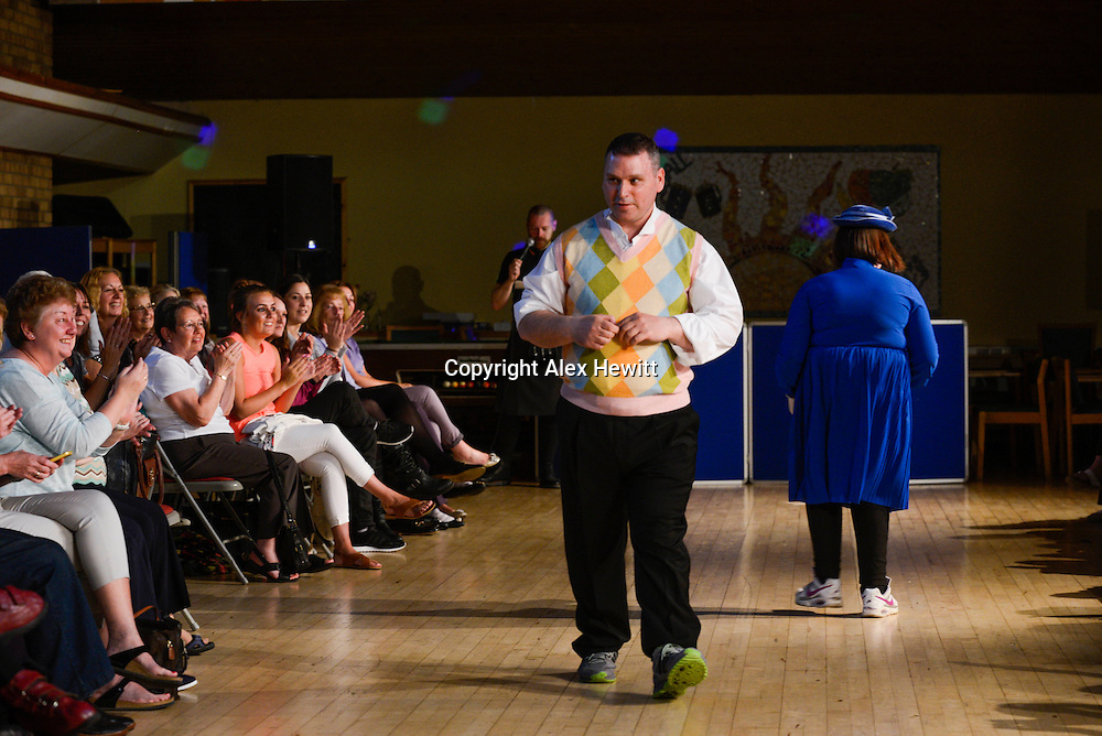 Adults with learning difficulties take to the catwalk dressed up on the theme of books at the North Edinburgh Community Arts Group annual charity fashion show at Craighall House.<br /> <br /> Staff and Volunteers helped the arts group's users to enjoy the glamour of literary life with clothes from All Together Edinburgh on Leith Walk as they strutted down the catwalk  in front of a full house of around 150 people.<br /> <br /> picture by Alex Hewitt<br /> alex.hewitt@gmail.com<br /> 07789 871 540