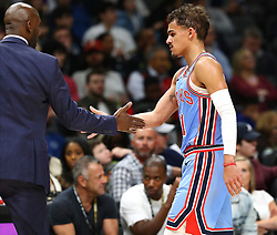 February 12, 2019 - Atlanta, GA, USA - Atlanta Hawks guard Trae Young gets five from head coach Lloyd Pierce in a 117-113 victory over the Los Angeles Lakers on Tuesday, Feb. 12, 2019 in Atlanta, Ga. (Credit Image: © Curtis Compton/Atlanta Journal-Constitution/TNS via ZUMA Wire)