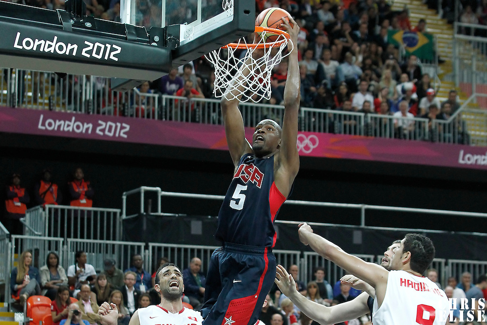 31 July 2012: USA Kevin Durant dunks the ball during 110-63 Team USA victory over Team Tunisia, during the men's basketball preliminary, at the Basketball Arena, in London, Great Britain.