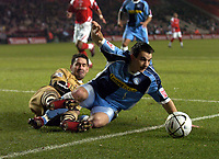 Photo: Olly Greenwood.<br />Charlton Athletic v Wycombe Wanderers. Carling Cup. 19/12/2006. Wycombe's Matt Blomfeild tackles Charlton's Scott Carson