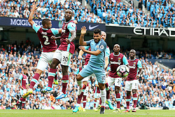 Sergio Aguero of Manchester City climbs with Michail Antonio of West Ham United for a header - Mandatory by-line: Matt McNulty/JMP - 28/08/2016 - FOOTBALL - Etihad Stadium - Manchester, England - Manchester City v West Ham United - Premier League