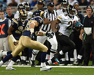 Jackson Jaguars running back Fred Taylor (28) races past St. Louis defenders DeJuan Groce (24) and Mike Furrey (25) for a 71-yard touchdown run in the first quarter at the Edward Jones Dome in St. Louis, Missouri, October 30, 2005.  St. Louis beat Jacksonville 24-21.