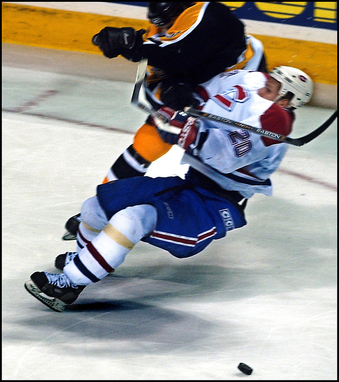 (04/25/2002-Montreal, Canada) Boston Bruins vs Montreal Canadiens. Kyle McLaren takes out Richard Zednik in the 3rd with a forearm toi the head.  (042502bruinsmjs-Staff Photo by Michael Seamans. Saved in Photo Friday.)