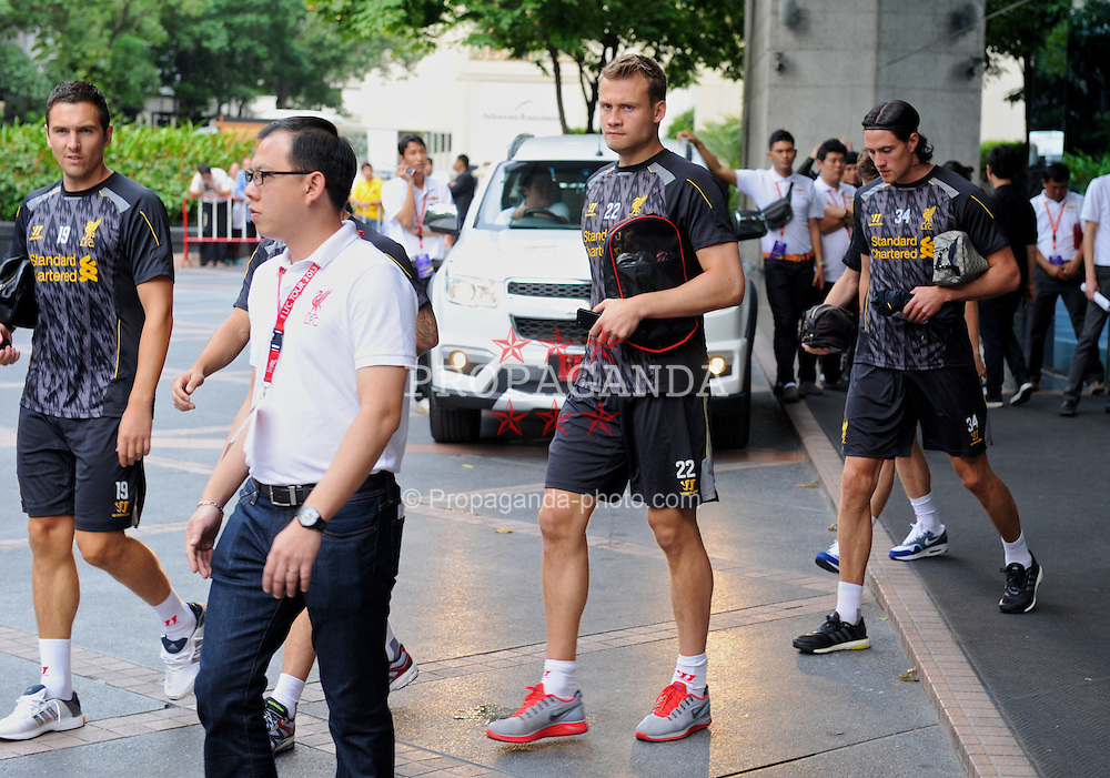 BANGKOK, THAILAND - Friday, July 26, 2013: Liverpool's goalkeeper Simon Mignolet walks out of the Plaza Athenee Hotel on the way to a training session ahead of the preseason friendly match against Thailand. (Pic by David Rawcliffe/Propaganda)