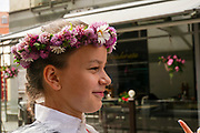 Young Latvian woman with a flower's wreath
