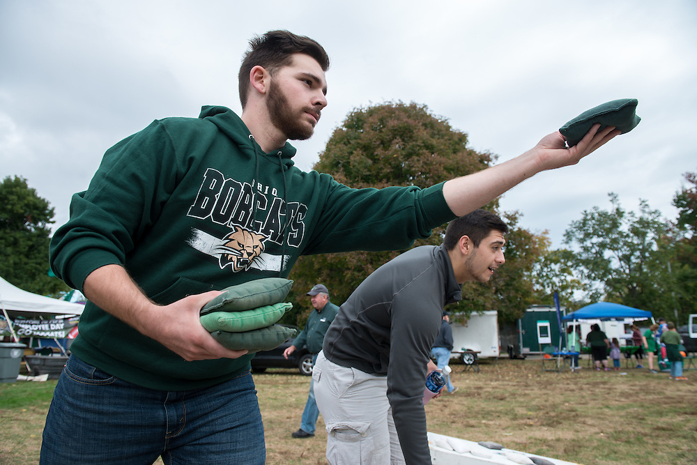 Roommates Lukas Sparks, left, and Nathan Donovan play cornhole before the 2016 Homecoming football matchup against Bowling Green at Tailgreat Park on Saturday, October 8, 2016.