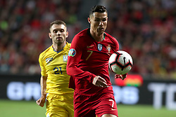 March 22, 2019 - Lisbon, Portugal - Portugal's forward Cristiano Ronaldo vies with Ukraine's defender Oleksandr Karavaev during the UEFA EURO 2020 group B qualifying football match Portugal vs Ukraine, at the Luz Stadium in Lisbon, Portugal, on March 22, 2019. (Credit Image: © Pedro Fiuza/NurPhoto via ZUMA Press)